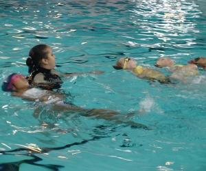 Children kicking back on floats